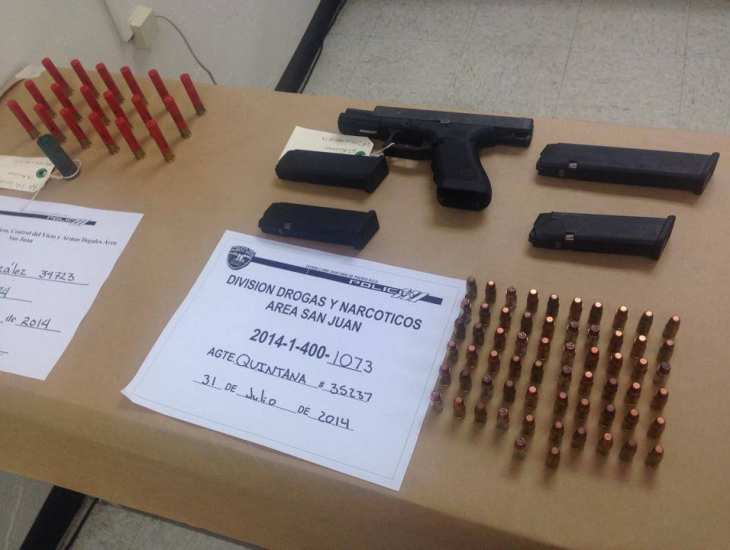 Armas y municiones confiscadas en allanamiento del 31 de julio de 2014